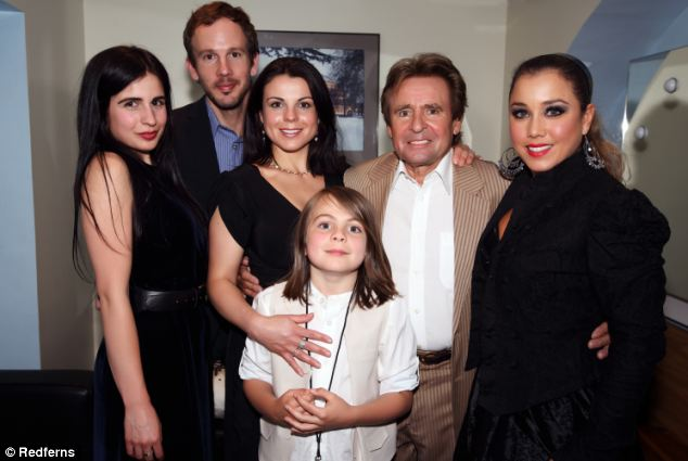 Family man: Davy Jones with his family Annabel Jones, Josh Cramer, Jessica Jones and son Phoenix Burrows with Davy and wife Jessica Pacheco backstage at Royal Albert Hall in London on May last year