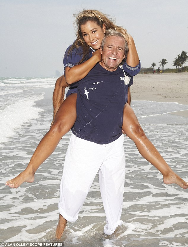 Boyish charm: Davy Jones pictured with his wife Jessica on the beach at their home in Florida last year