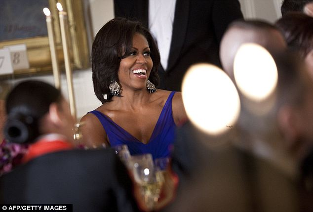 There's a smile! The First Lady got into the spirit of the evening eventually and shared some laughs