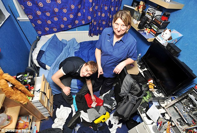 Ryan Kitching, 19 was nagged by his mother Susan (right) into finally tidying up his bedroom - and struck gold by finding a lost lottery ticket worth £52,981
