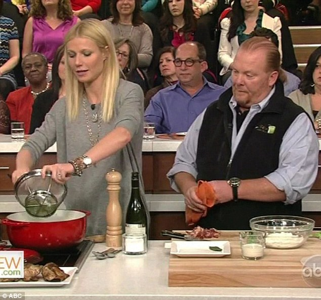Showing him how its done: Gwyneth Paltrow showed off her cooking skills in front of Mario Batali on the set of The Chew
