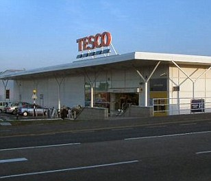 Ryan left the ticket at the Tesco store's kiosk to get it checked and, as he walked away, a friend shouted after him, saying he had 'won big'