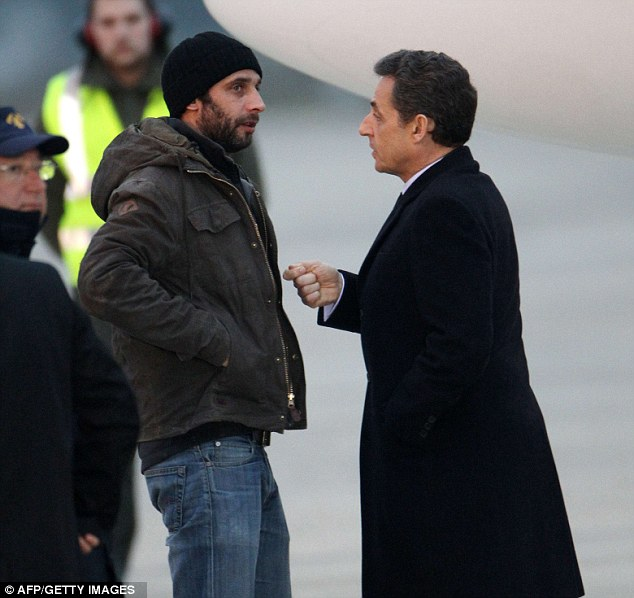 Presidential greeting: French photographer William Daniels speaks with Nicolas Sarkozy after the plane carrying him and Ms Bouvier landed