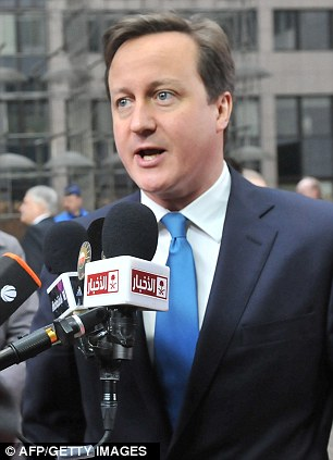 EU summit: Prime Minister David Cameron today said the Syrian government will face a 'day of reckoning' for the atrocities it is committing against its people