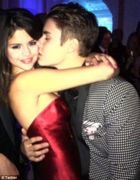 Reunited: Selena Gomez looked delighted to be back in boyfriend Justin Bieber's arms to help him celebrate his 18th birthday