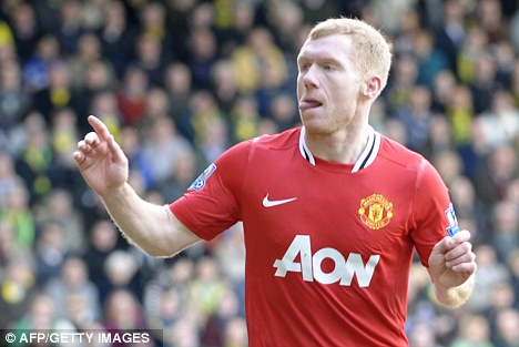 Carry on playing: Sir Alex Ferguson believes Paul Scholes will play on next season