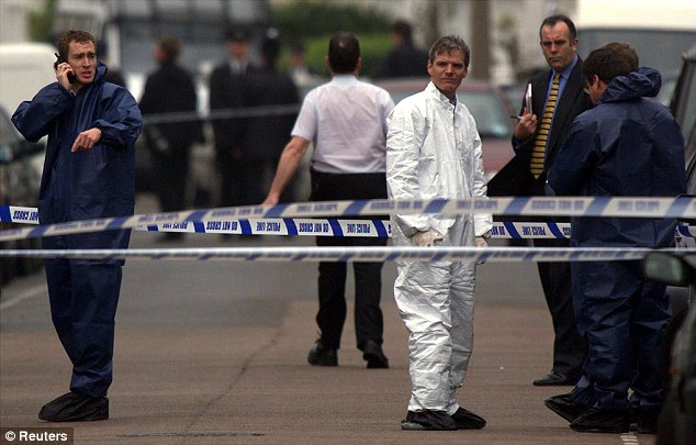 Murder scene: Police officers cordon off Jill Dando's road in Fulham, south London, following the shooting in April 1999