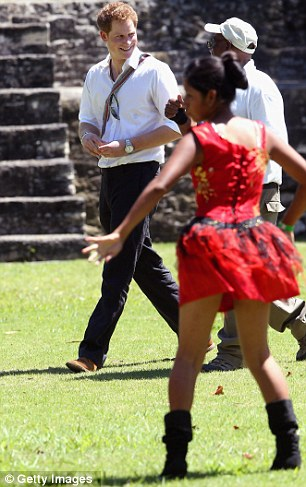 Lady in red: There were dancing girls aplenty as the prince made his way around the ruins