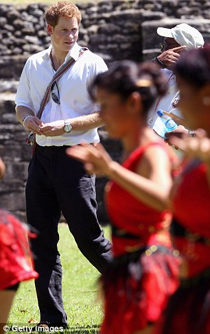 And if you look over here: Red-clad young dancers in the foreground compete for the prince's attention as his guide tries to show him more historic fayre