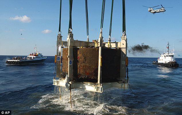 Recovery: The turret of the Civil War ironclad USS Monitor is lifted out of the ocean off the coast of Hatteras, N.C. on August 5, 2002