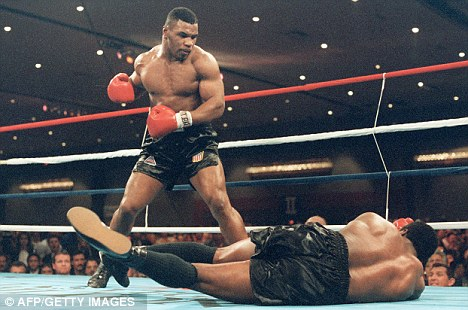 Past: Tyson (left) became the youngest heavyweight world champion in history