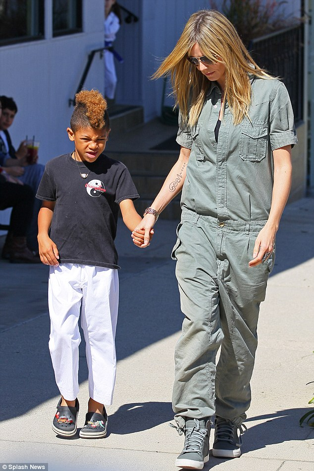 Marching on: Heidi was spotted taking her sons to karate class wearing a baggy khaki jumpsuit