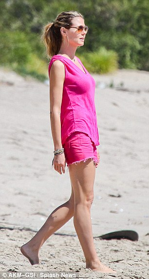 Pretty in pink: Heidi looked striking in her hot pink ensemble