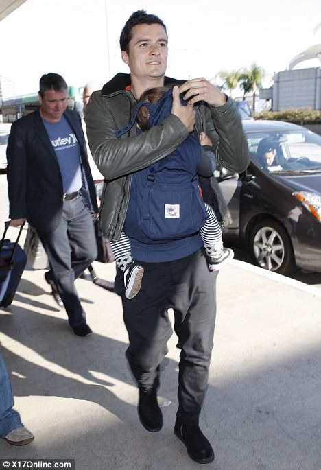 Off again: Orlando recently admitted he hates spending time apart from his son as he undergoes his hectic filming schedules