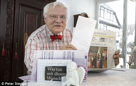 Beneficiary: Armin Kraft, from Children in Poverty in Braunschweig was one of the lucky residents who received wads of euro notes