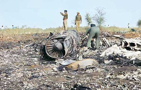 An IAF personnel inspects the Mirage 2000 engine near Baman Bass village, Rajasthan