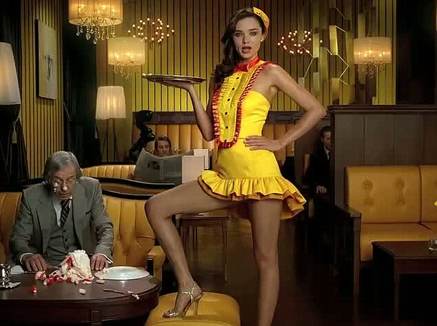 Angelina's got nothing on her! Miranda Kerr is seen showing off her slender legs in a yellow and red minidress in a new Japanese advert for Lipton Limone iced tea