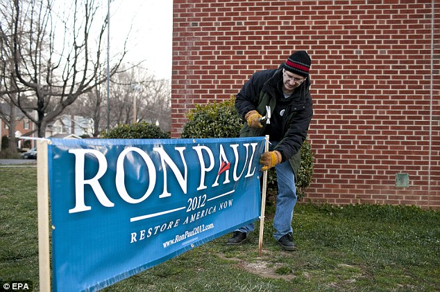 Virginia: A Ron Paul sign on Super Tuesday is staked down in Roanoke, Virginia whose state only Romney and Ron Paul fulfilled the requirements to get on the ballot for