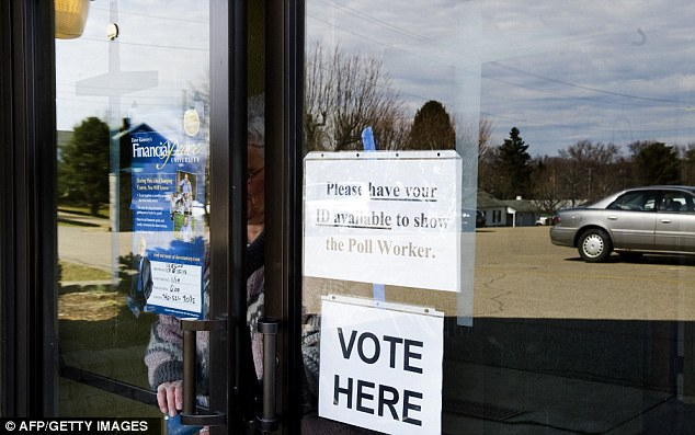 Shoot-out: Ohio voters took to the polls today where its a straight shoot-out between Republican presidential candidates Mitt Romney and Rick Santorum