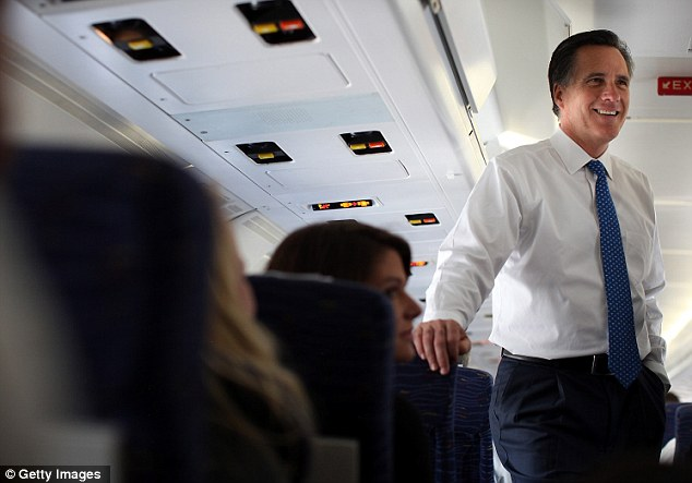 Victories: Seen aboard a campaign plane to Boston today, Mitt Romney has scored victories in over five states which when combined with the remaining delegates at stake, could give him an almost unassailable lead in the quest to secure his party's ticket