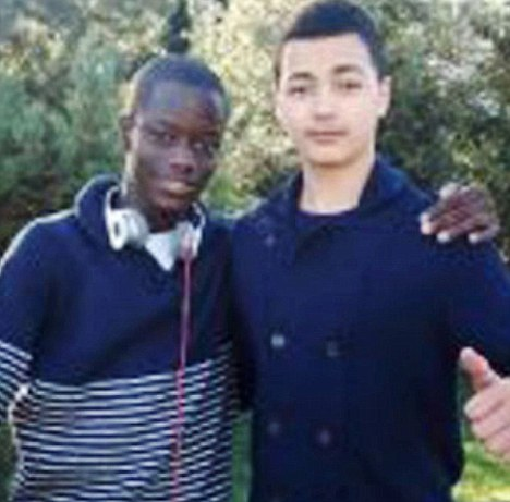 Victim: 15-year-old Kristy Bamu, pictured left with a friend, suffered 130 injuries after being hit with an arsenal of weapons including broken ceramic floor tiles
