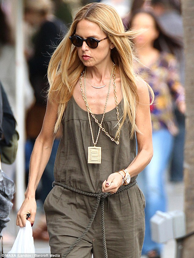 Gaunt: Rachel Zoe stepped out baring her bony chest and rail thin arms in an army green jumpsuit as she visited Sprinkles Cupcakes in Beverly Hills yesterday