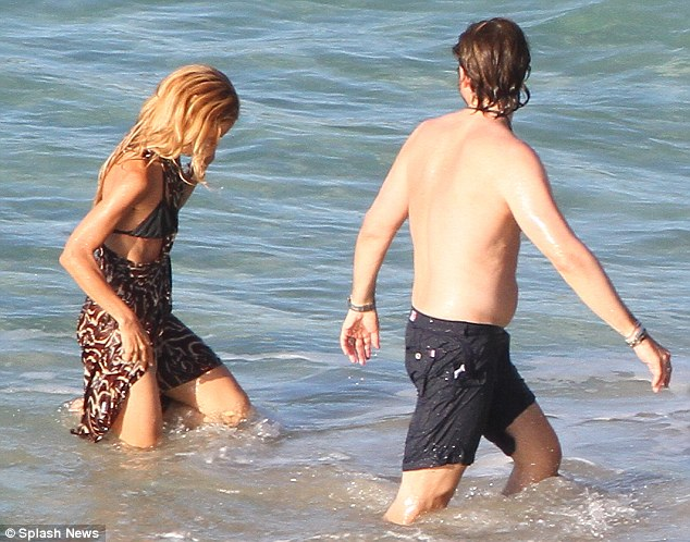 Modest: While most would have left the cover up on the shore, body-conscious Rachel demurred and went in the ocean fully clothed
