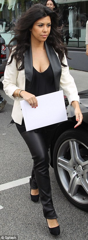 Scouting: Meanwhile Kim's pregnant sister Kourtney slipped into some leather trousers to scout a location for the sister's store Dash in Melrose Avenue