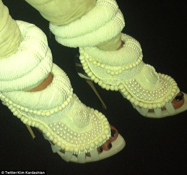 'In love': Kim tweeted a picture of the Kanye West for Guiseppe Zanotti heels she was wearing tonight to  attend the rapper's fashion show