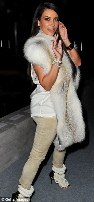 Star appearance: She arrived at the show wearing the shoes with an outfit consisting of a pair of beige trousers, a white top and a fur shawl