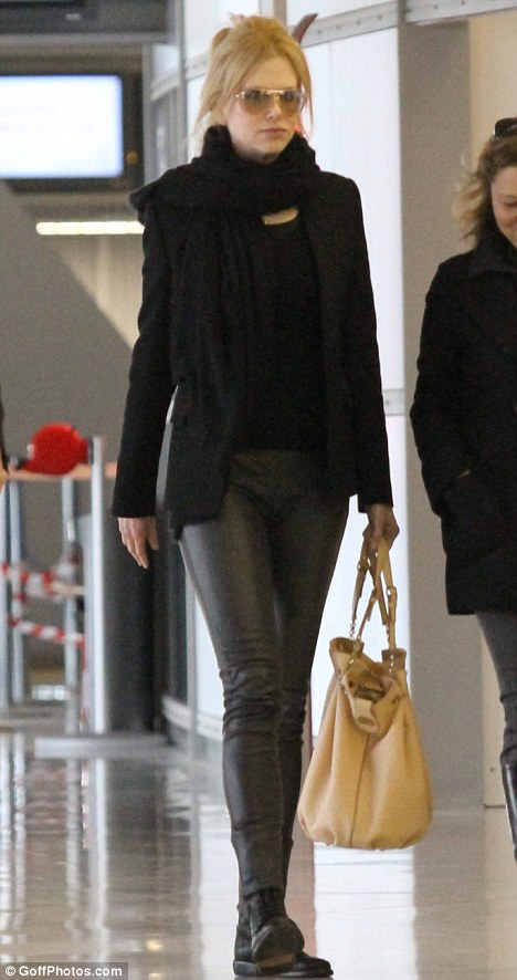 Hell for leather: Nicole Kidman rocked a very different look from her usual style in leather trousers as she jetted out of Paris today