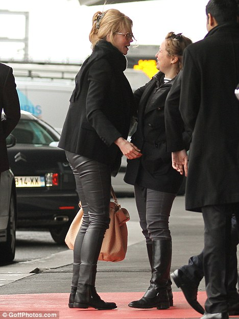 Moody: Nicole wore head to toe black for her flight