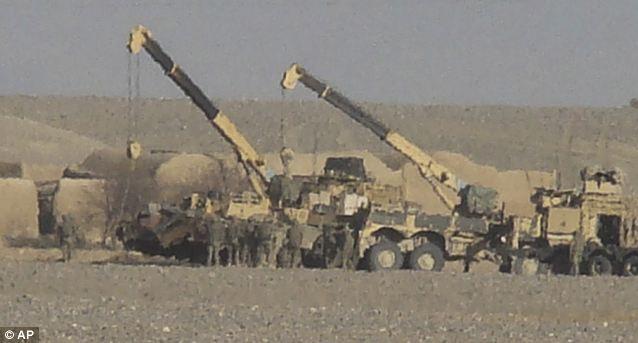 Death in the desert: British vehicles surround the shattered Warrior