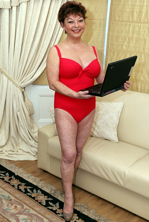 Eye-catching: Louise posing in the £35 red Lycra swimsuit which helped attract 900 admirers
