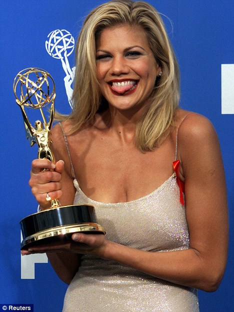 Celebratory: Johnston with the second of her two Emmy Awards for 3rd Rock from the Sun