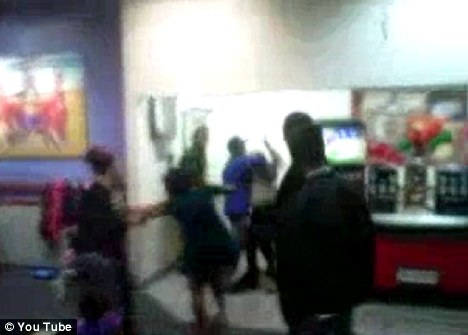 Two women are restrained as they attempt to fight each other during a birthday party at a Chuck E Cheese