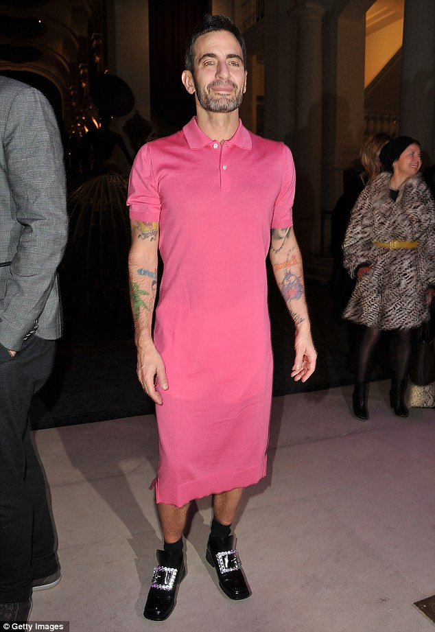 Feeling pink: Designer Marc Jacobs attends a photocall for his work with Louis Vuitton: The Exhibition as part of Paris Fashion Week