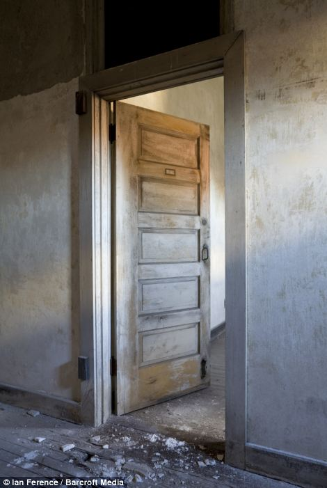 Door to patient room in 1909 isolation ward photographed in Ellis Island hospital in New York City