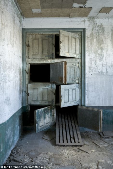 A view of eight tray vertical morgue in 1909 mortuary building in Ellis Island hospital in New York City