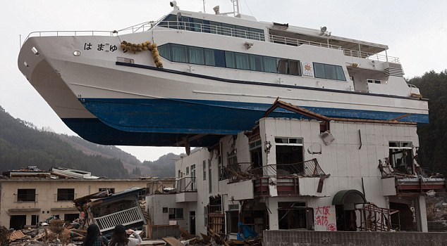 Aftermath: A catamaran sightseeing boat sits on top of a two story building in Otsuchi town, Iwate