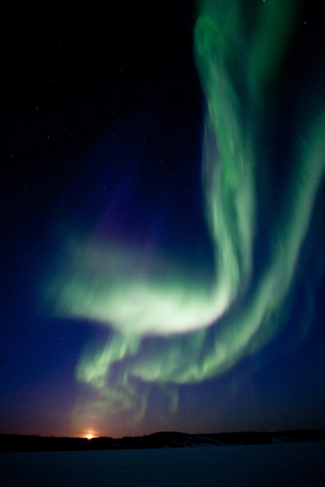 The aurora australis lights up the sky over Australia after a new sunspot group blasted Earth's magnetosphere this week