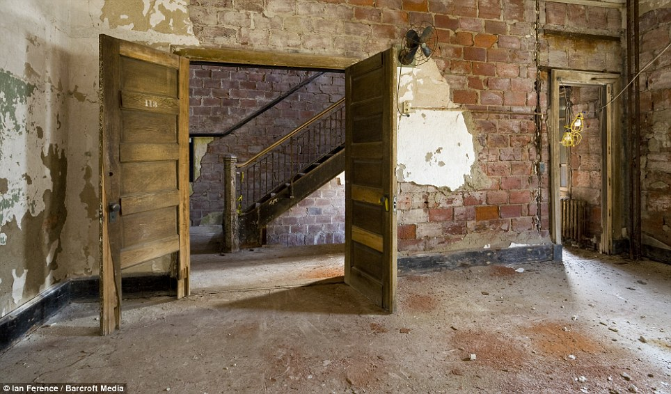 Treatment: Much of the plaster has fallen from the walls in one of the isolation hospital wards. Many of those who arrived would be quarantined if they showed signs of illness