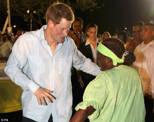 Prince Harry dances with a local woman