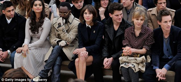 Cameras at the ready: Another starry line-up at Burberry during London Fashion Week 2012 - from left, Amir Khan, Sonam Kapoor, will.i.am, Alexa Chung, Jeremy Irvine, Clemence Poesy and Eddie Redmayne