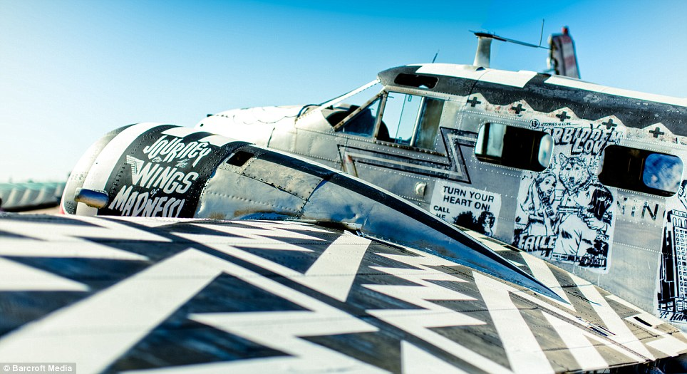Makeover: A painted Beechcraft C-45 model airplane called 'Naughty Angels' by artist Faile, part of the one in a lifetime event