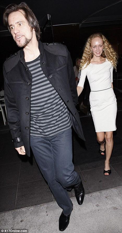 Going coastal: Jim Carrey treats his girlfriend Anastasia Vitkina to dinner at Katsuya in Los Angeles last night