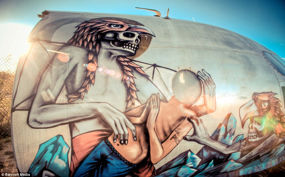 Team effort: 30 of the world's best urban artists worked on the ruined jets to bring them back to life