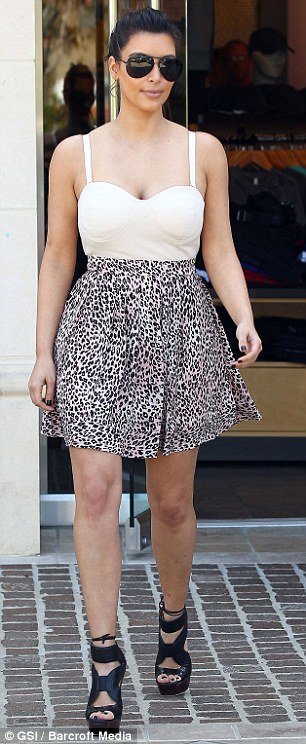 Walking on the wild side: The reality star wore a eye-catching outfit which included a cleavage baring top half and animal print bottom