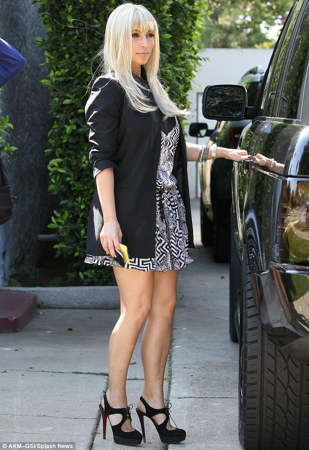 Blondes have more fun: Kim Kardashian stepped out in a platinum wig to fool photographers in Los Angeles