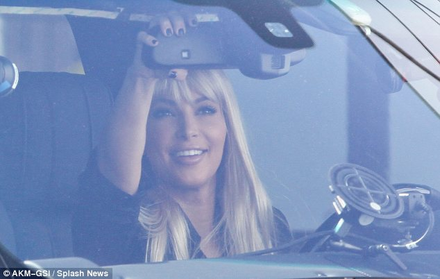 Liking the look: Kim was clearly please with her new barnet as she beamed at her reflection
